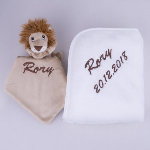 Baby's Lion comforter & white fleece blanket both embroidered, in brown, with the name Rory & date of birth