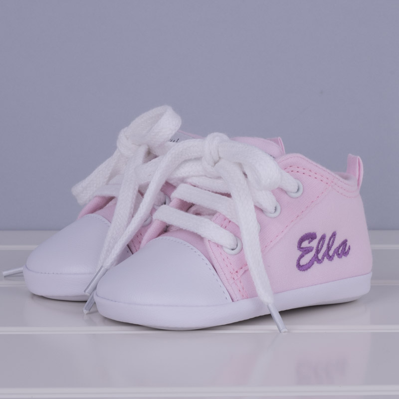 16e0ef3d5c6b Pink baby shoes for girls personalised with the name Ella grey background    on an angle