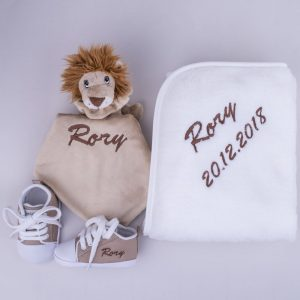 Lion baby's comforter, Sand coloured baby shoes & white fleece blanket and personalised with the name Rory