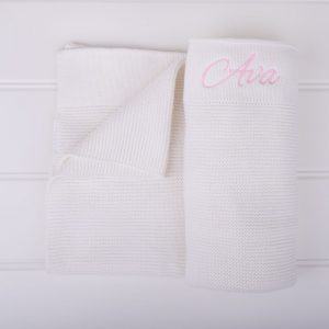 White knitted blanket with the name Ava embroidered