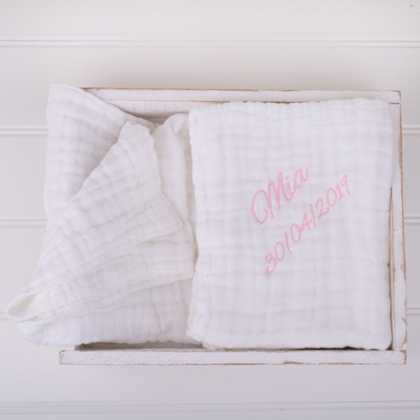Large white muslin baby's blanket personalised with the name Mia and date of birth