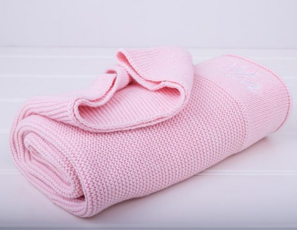 Rolled Personalised Pink Knitted Blanket on an angle with Mia embroidered