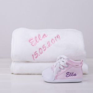 Pink baby shoes & white fleece blanket both personalised with the name Ella