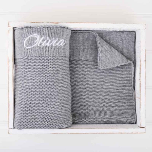 Grey Knitted Baby's Blanket embroidered in white with the name Olivia