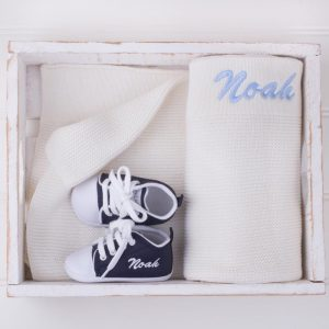 Navy Blue Shoes in front of a white kitted blanket