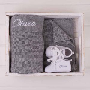 Personalised Grey Knitted Blanket & White Shoes personalised with the name Olivia