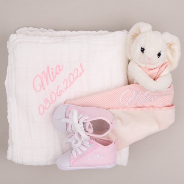 White Muslin baby's blanket, pink baby shoes & a pink baby comforter personalised with the name Mia
