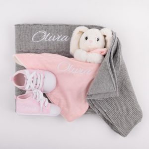 Grey Knitted Blanket, Bunny Comforter & Baby Shoes all personalised with the name Olivia
