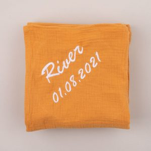 Personalised Yellow Mustard Organic Muslin Wrap personalised with the name River
