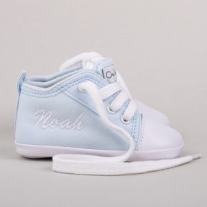 Light blue baby shoes for boys personalised with the name Noah in white and grey background