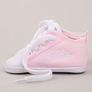 Pink baby shoes personalised with the name Mia with grey background