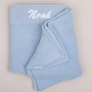 Personalised Blue Knitted Blanket embroidered with the name Noah in white
