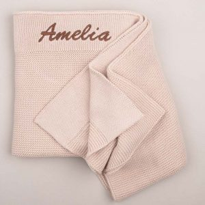 Personalised Beige Knitted Blanket embroidered with the name Amelia in brown writing