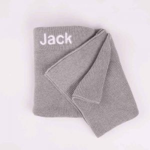 Grey Knitted Baby's Blanket embroidered in white with the name Jack