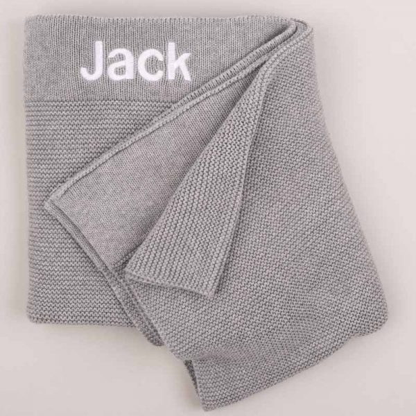 Grey Knitted Baby's Blanket embroidered in white with the name Jack with grey background