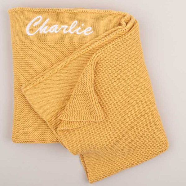 Personalised Yellow Mustard Pink Knitted Blanket personalised with the name Charlie in white
