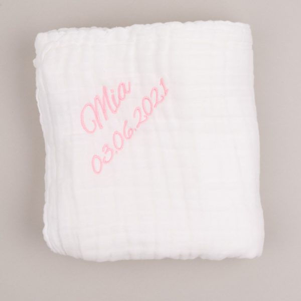 Large white muslin baby's blanket folded and personalised in pink Mia