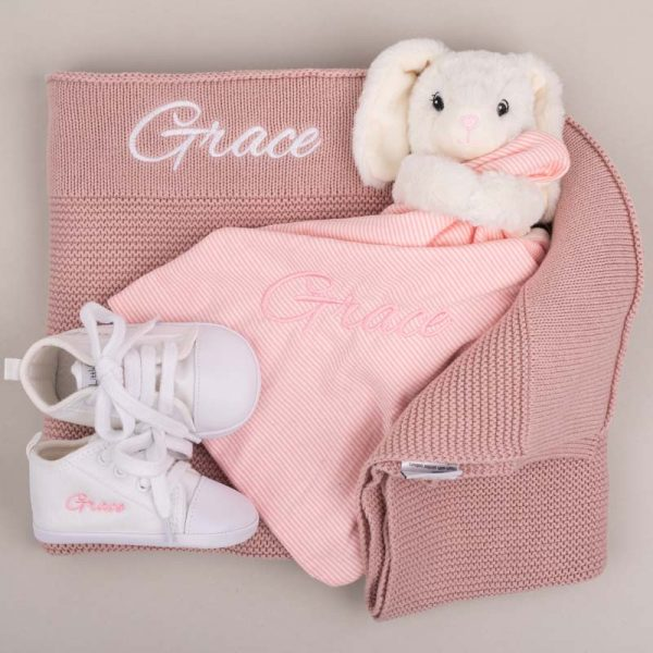 Blush Pink Knitted Blanket, Bunny Comforter & White Baby Shoes embroidered with the name Grace grey background