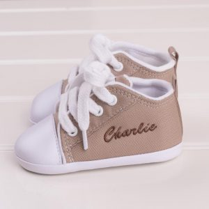 Sand coloured baby shoes personalised with the name Charlie