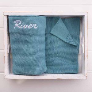 Personalised Ocean Blue Knitted Blanket embroidered with the name River