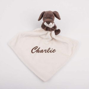 Brown puppy baby comforter head turned right and personalised with the name Reuben