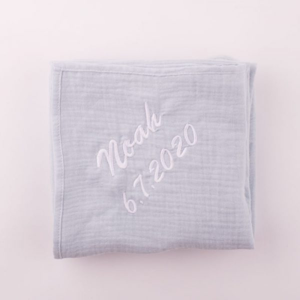 Personalised Light Blue Organic Muslin Wrap personalised with the name Noah