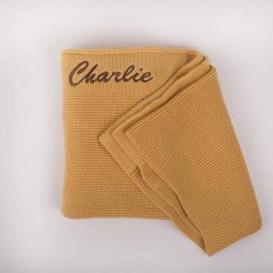 Personalised Yellow Mustard Pink Knitted Blanket personalised with the name Charlie