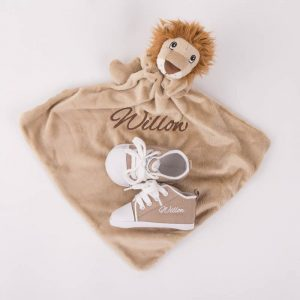 Light brown lion comforter & sand coloured baby shoes both personalised with the name Willow