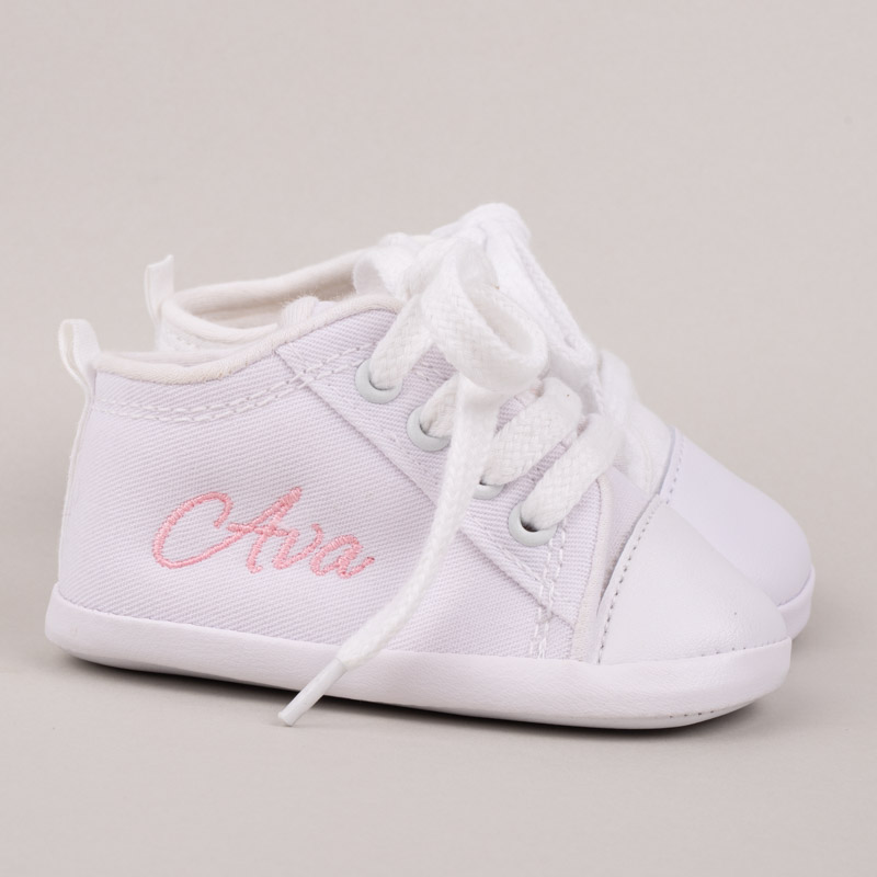 White baby shoes personalised with name Ava in pink